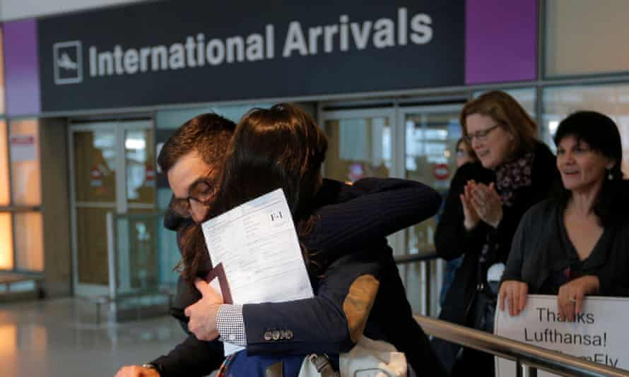 Behnam Partopour, a student from Iran, is greeted by his sister at Logan Airport after he cleared US customs in Boston on 3 February 2017.