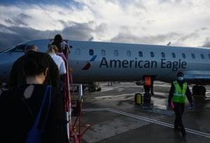 Passengers board an American Airlines flight at Ronald Reagan Washington National airport in Arlington, Virginia.