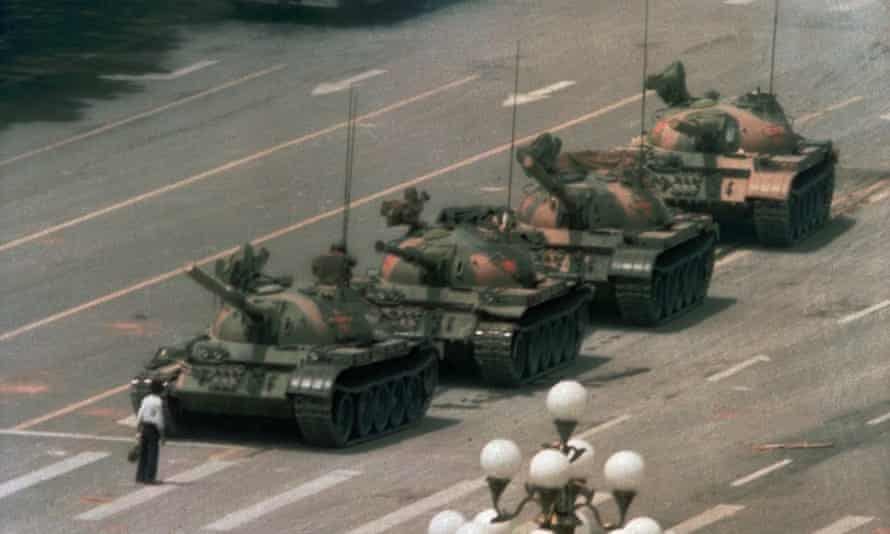 A man blocks a line of tanks heading east on Beijing's Cangan Blvd in Tiananmen Square on 5 June 1989.
