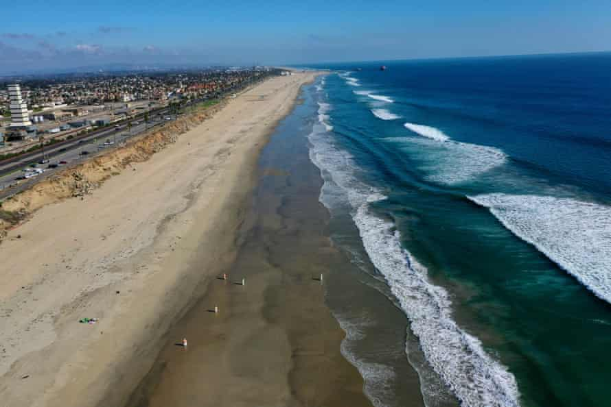 Environmental crews work to clean up a major oil spill at Huntington Beach, California Tuesday.