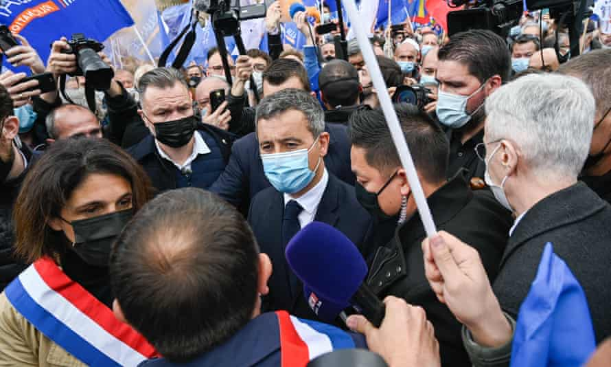 Gérard Darmanin (centre) at the protest by police in Paris on Wednesday.