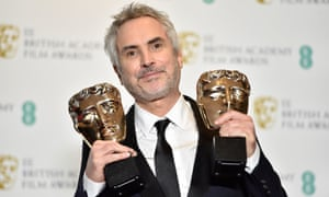 Alfonso Cuarón with the best film and best director awards at this year's Baftas.