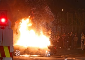 A hijacked car explodes after being set on fire in Creggan, Londonderry.