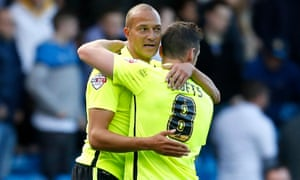 Bobby Zamora of Brighton and Hove Albion celebrates with Andrew Crofts after the win over Leeds.