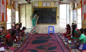 Runa Akter teaches 14 boys and 14 girls on NGO Brac's boat school, near Brahmanbaria, 100km east of Dhaka