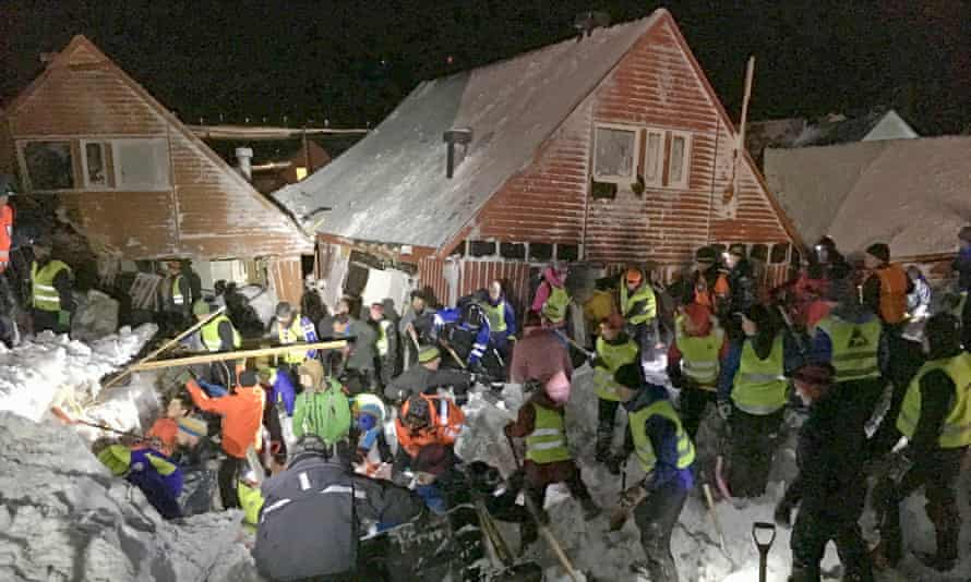 Search crews with shovels worked to free people from buried houses after an avalanche hit several houses in Longyearbyen, Norway.