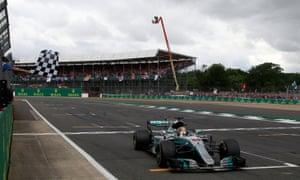 Mercedes' Lewis Hamilton crosses the finish line to win.