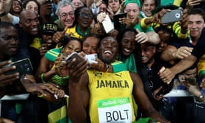 Usain Bolt celebrates with fans in Rio after winning the 200m final at the Olympic Stadium on Thursday.