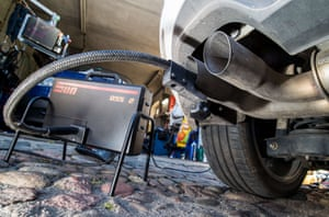 A measuring hose for emissions inspections in diesel engines sticks in the exhaust tube of a Volkswagen (VW) Golf 2,0 TDI diesel car at a garage in Frankfurt an der Oder.