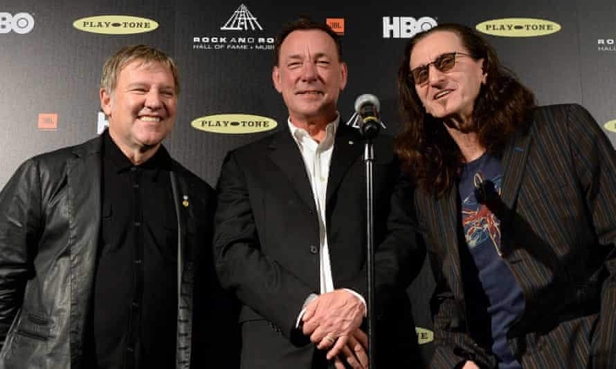 Alex Lifeson, Neil Peart, and Geddy Lee pose in the press room at the 28th Annual Rock and Roll Hall of Fame Induction Ceremony in Los Angeles.