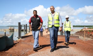 Adam Giles, walks with Port Melville chairman Andrew Tipungwuti, left, at Port Melville in the Tiwi Islands on Thursday 5 March 2015.