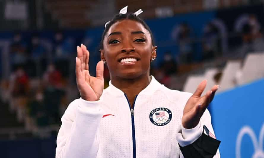 GYMNASTICS-OLY-2020-2021-TOKYO<br>USA's Simone Biles applauds during the artistic gymnastics women's team final during the Tokyo 2020 Olympic Games at the Ariake Gymnastics Centre in Tokyo on July 27, 2021. (Photo by Loic VENANCE / AFP) (Photo by LOIC VENANCE/AFP via Getty Images)