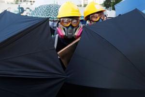 Umbrella-wielding protesters
