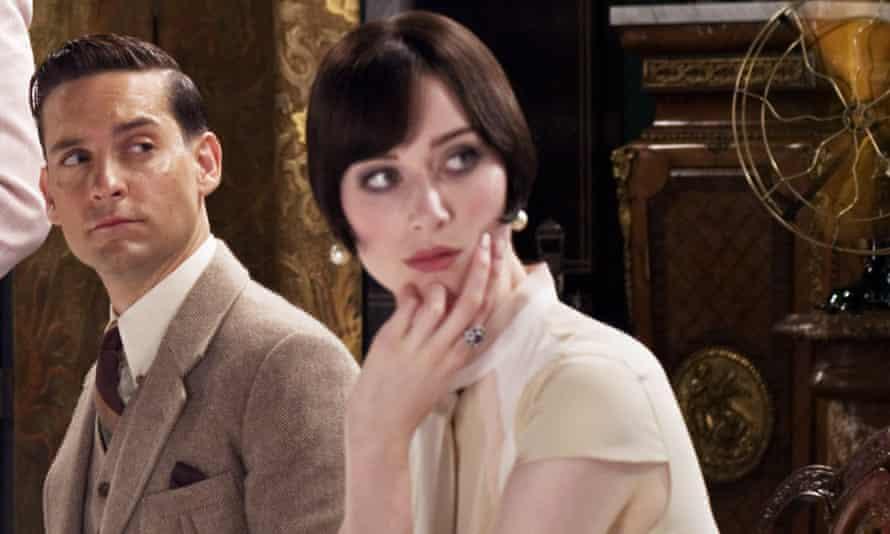 Tobey Maguire as Nick Carraway and Elizabeth Debicki as Jordan Baker in the 2013 film.