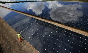 A worker cleaning panels at Landmead solar farm near Abingdon.