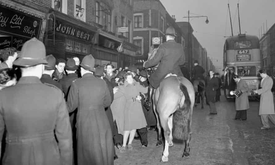 Police break up clashes between followers of Sir Oswald Mosley and protestors in Ridley Road on 20 March 1949.