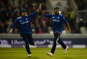 Rashid celebrates with Morgan after dismissing Finch.