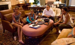 The Obamas watch TV at home in the White House residence in 2011, photographed by Pete Souza.