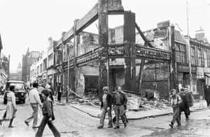 Burnt Out In Brixton Locals walk past a building destroyed during the second night of rioting in Brixton, 13th April 1981.