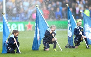 Cardiff, WalesYoung flag bearers get soaked by the ground's sprinkler system before the start of the match Cardiff City v Swansea City.