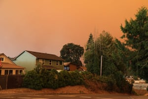 An orange-grey smoke-filled sky above Estacada, Oregon, as fires burn nearby. The Oregon forestry department fire chief warned of 'unprecedented times'.