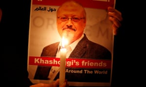 A demonstrator holds a picture of journalist Jamal Khashoggi outside the Saudi consulate in Istanbul.