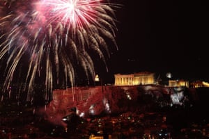 Fireworks illuminate the sky over the Parthenon in Athens, Greece