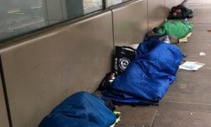 Homeless people sleeping rough in Victoria, London.