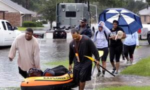 Residents use a raft to evacuate homes in Baton Rouge.