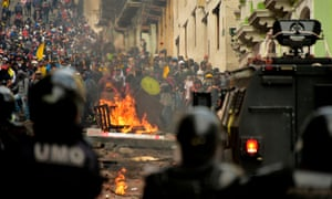 Demonstrators clash with riot police in Quito, Ecuador last week over a fuel price increase ordered by the government to secure an IMF loan.