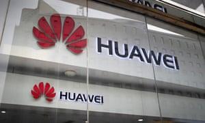 Huawei logos are seen in a shop window in Beijing.