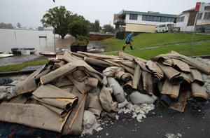Taree Aquatic Club manager Barry Murray walks past the pile of carpets that had to be removed