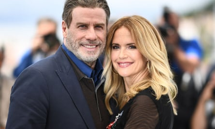 Kelly Preston and husband John Travolta pose during a photocall for the film Gotti in 2018. Preston died on Sunday from breast cancer.