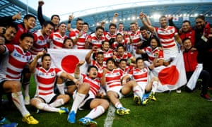 Japan players celebrate their victory over South Africa in the 2015 World Cup, arguably the biggest shock the tournament has ever witnessed.