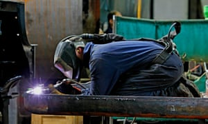 An engineer works on Flying Scotsman at Riley & Son locomotive works.