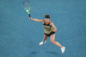 A leaping Elina Svitolina plays a forehand.
