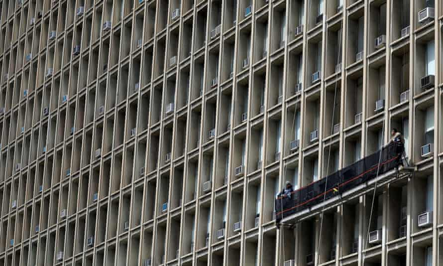 Window washers work on a building featuring rows of air conditioners in New York City on 22 April. It's estimated that if the world phased out HFCs the planet would avoid 0.5C in heating by the end of the century.