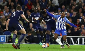 Jose Izquierdo of Brighton and Hove Albion is fouled by Serge Aurier of Tottenham Hotspur which leads to Brighton and Hove Albion being awarded a penalty.