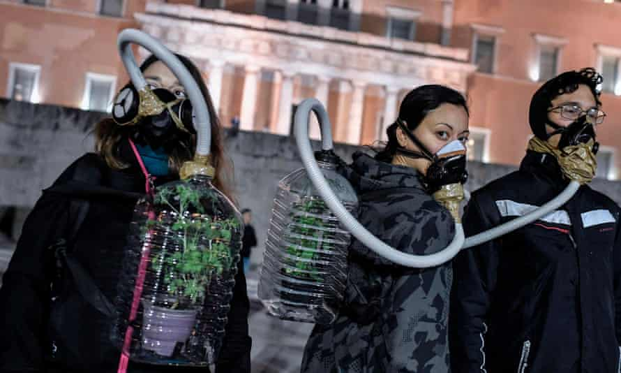 Environmental activists protest in front of the Greek parliament.