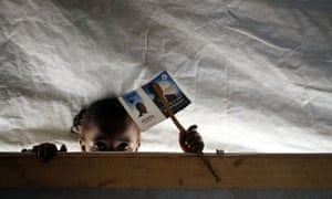 A child peers into a classroom in a school set in the Mpoko refugee camp in Bangui, Central African Republic