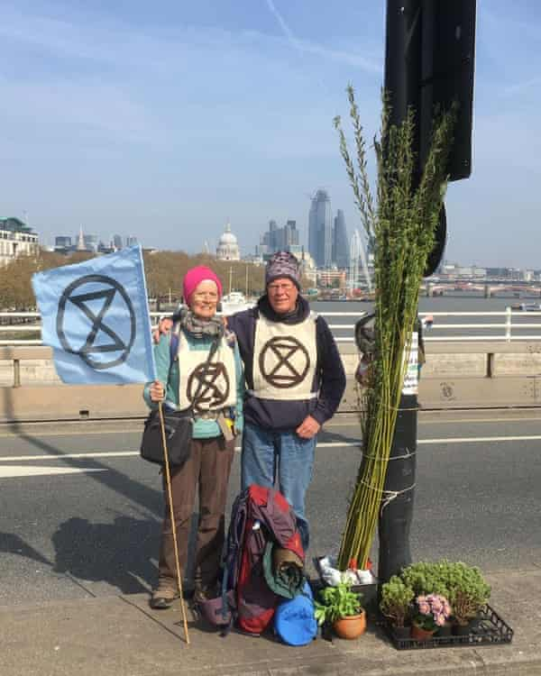 Anne and Robert Rivett, a retired GP, attend the Extinction Rebellion protest in London on Friday.