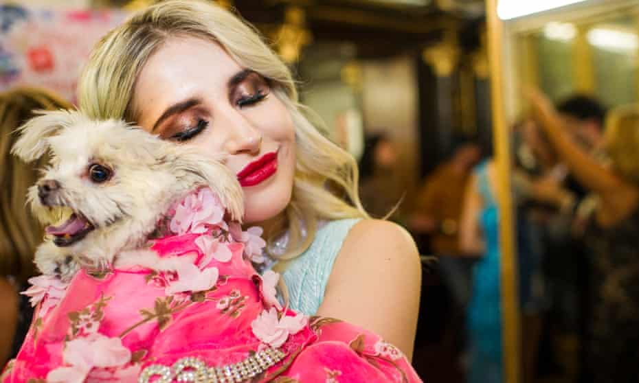 Two models cuddle after the show at the Anthony Rubio Spring/Summer 2018 Canine Couture show.