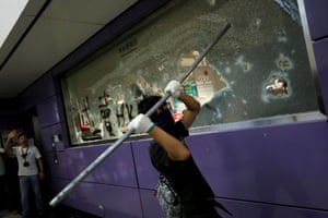 Anti-extradition bill protesters smashes Mass Transit Railway (MTR) facility as they accuse the railway operator of helping the government to catch protesters, at Tung Chung, September 1, 2019.