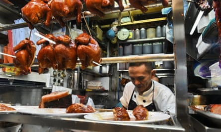 Chef Chan Hon Meng prepares meals at his stall in the Chinatown Complex in Singapore.