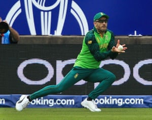 Faf du Plessis of South Africa takes a catch from Colin de Grandhomme of New Zealand.