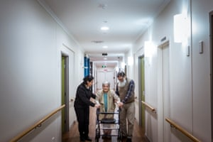 Jose and Roxana make sure Gladys walks around Chelsea Wing after her dinner for exercise.