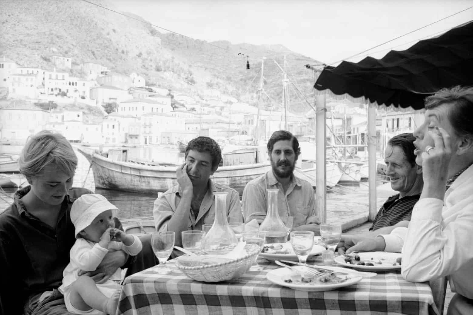 Marianne, left, with her baby son, Axel Jensen Jr, with Cohen (second left) and friends, Hydra, 1960.