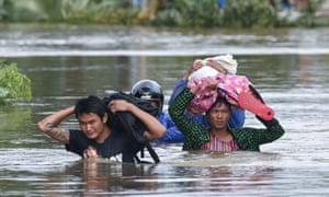 Residents evacuate Ye in south-east Myanmar after the region was deluged by monoon rains.