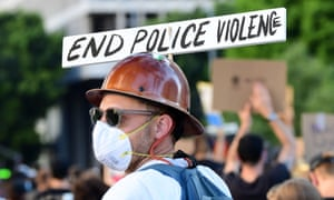 A demonstrator attends a protest against sytemic racism and police brutality.
