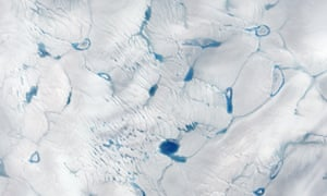 An image of early melting on the Greeland ice sheet taken by Nasa's Earth Observing-1 satellite on 15 June 2016.